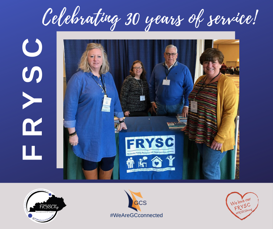 FRYSC DIRECTORS around a banner