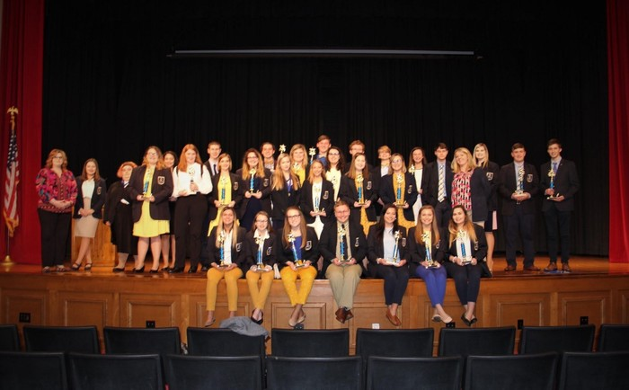 GCHS DECA Regional competitors on stage