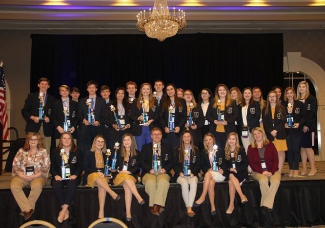 GCHS DECA on stage at State