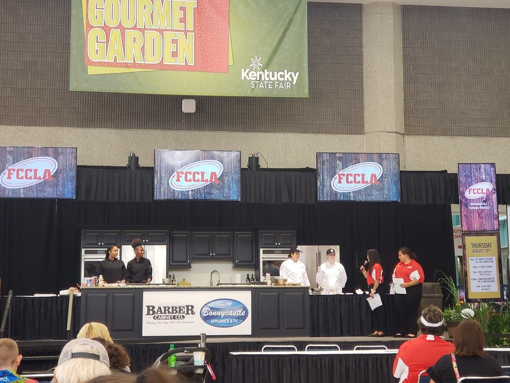 people on stage with culinary equipment FCCLA