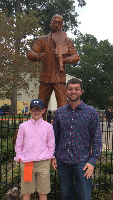 Alex Hazelwood & Adam French in front of fiddler statue