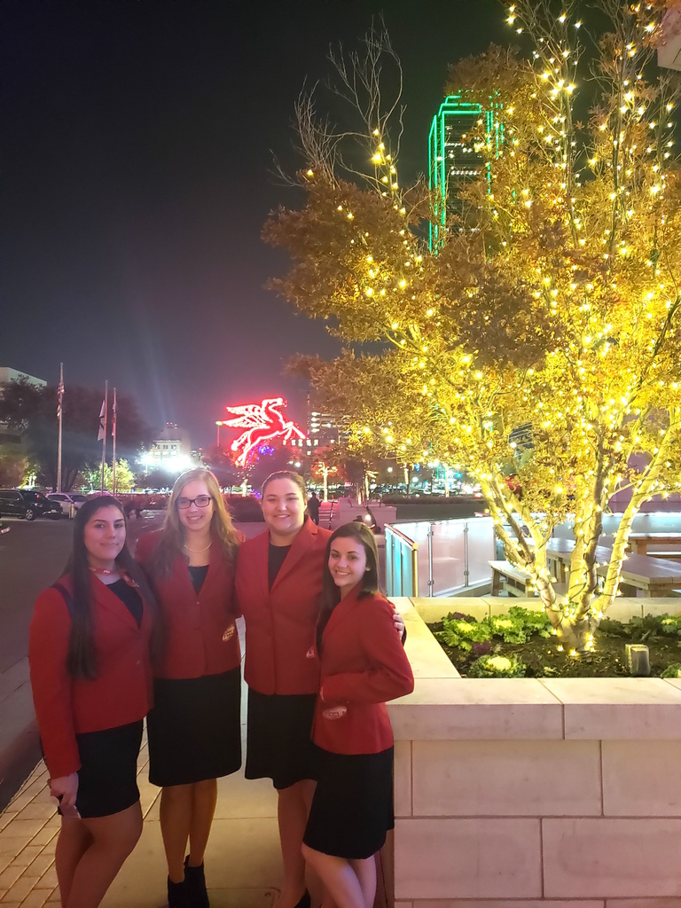 FCCLA Competitors by lit tree outside