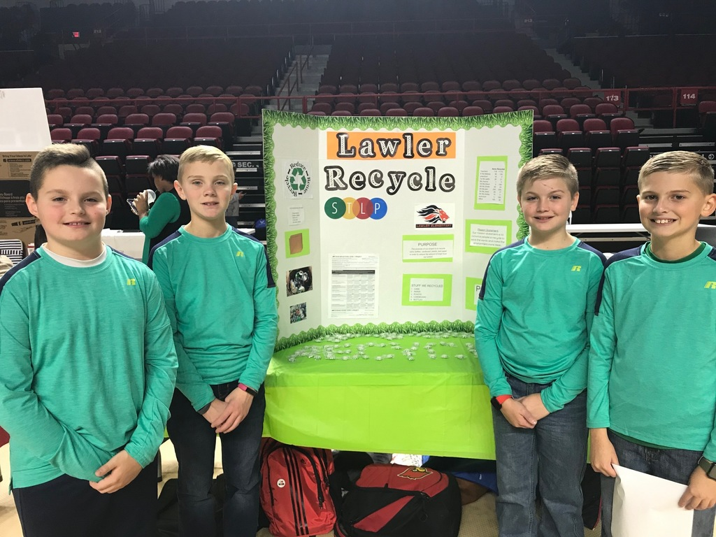 Recycling Team in front of display