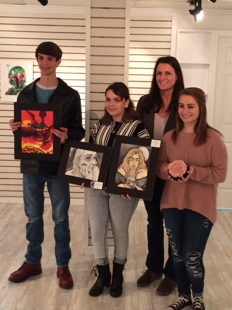 Ethan Pierce, Tessa Combs, Beverly Dowell and Aleah Clemons with artwork