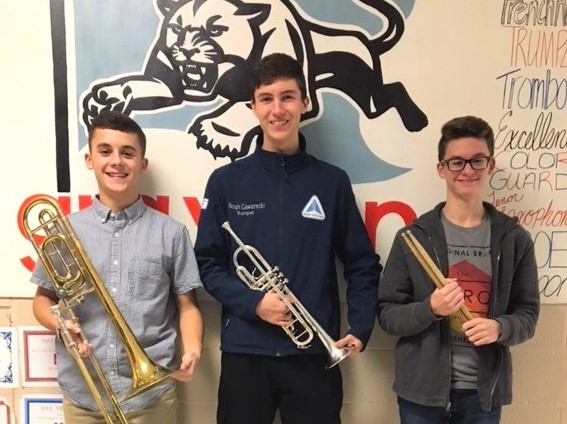 Jackson Parker, Noah Gawarecki and Mason Parker with instruments