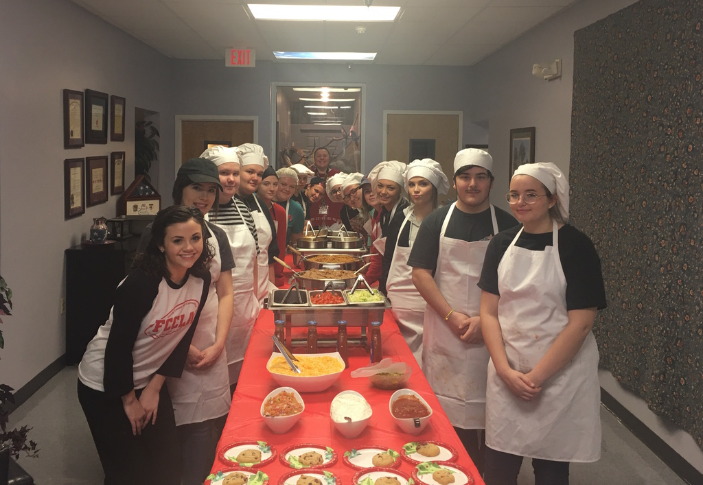 GCHS Culinary students posed around tables