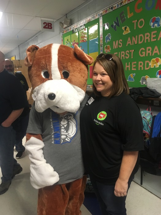 Wilkey bulldog mascot makes friends with a bel employee