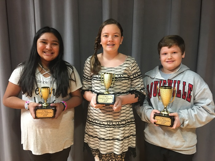 5th grade spelling bee winners with trophies