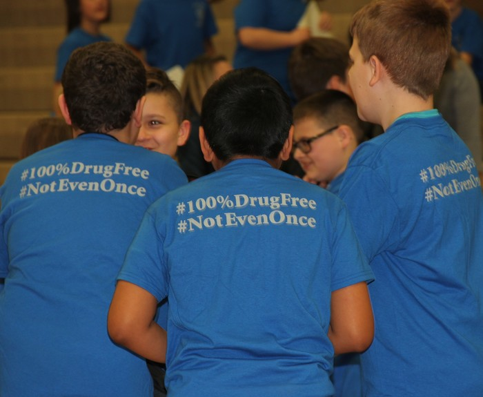Back of group of boys in anti-drug t-shirts