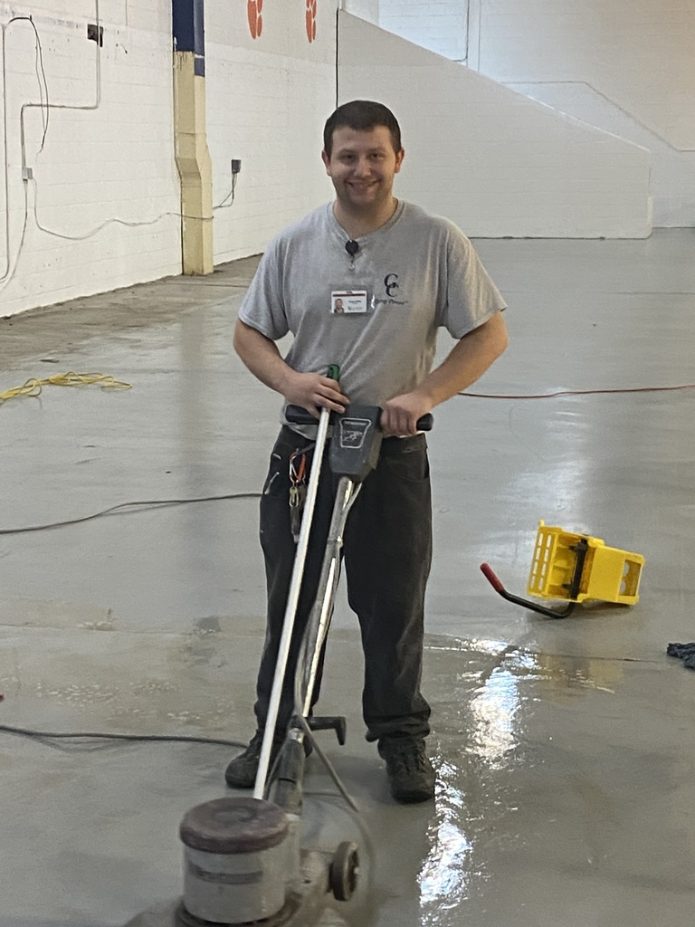 man buffing floor