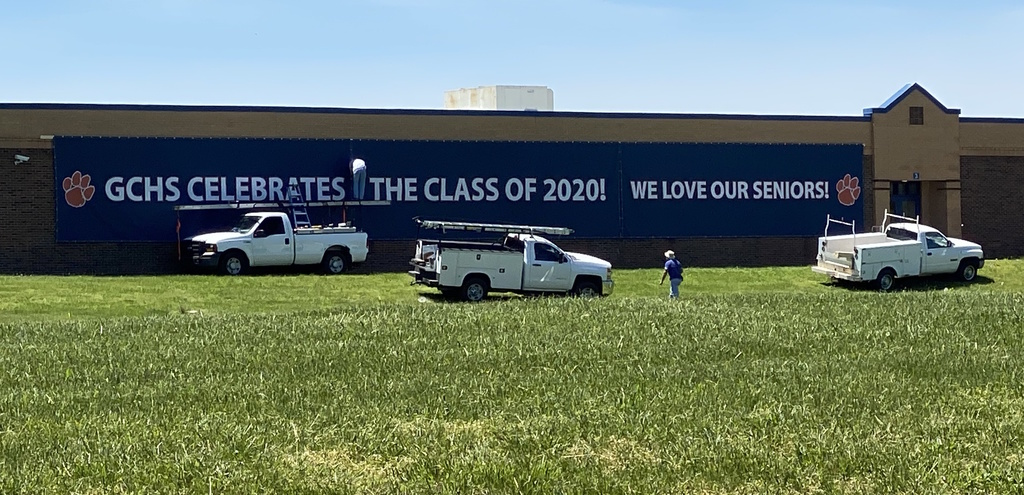 Trucks in fron of Class of 2020 banner on front of GCHS