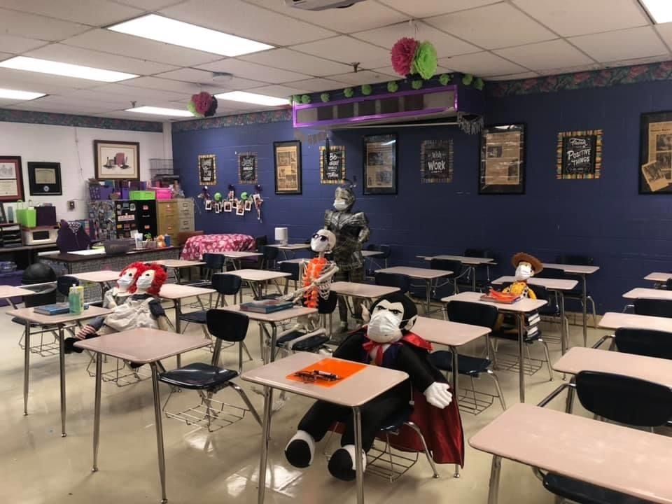 Classroom with masked stuffed vampire, skeleton and knight